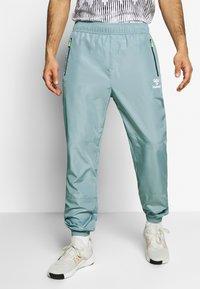 Hummel - MAGNUS PANTS - Pantaloni sportivi - quarry - 0