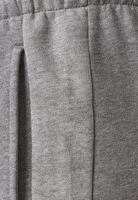 Hummel - ACTIVE  - Tracksuit bottoms - dark grey melange - 4