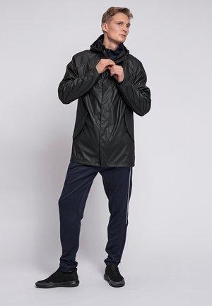 HMLROONIE - Waterproof jacket - black