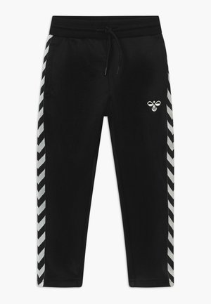 KICK - Tracksuit bottoms - black