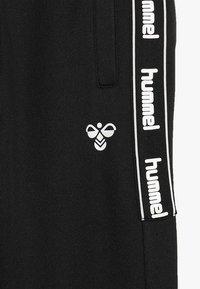 Hummel - HMLASK PANTS - Pantalones deportivos - black - 4