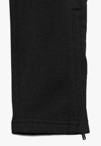 Hummel - HMLASK PANTS - Pantalones deportivos - black - 2