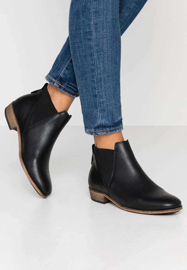 KIM - Ankle boots - black/natural