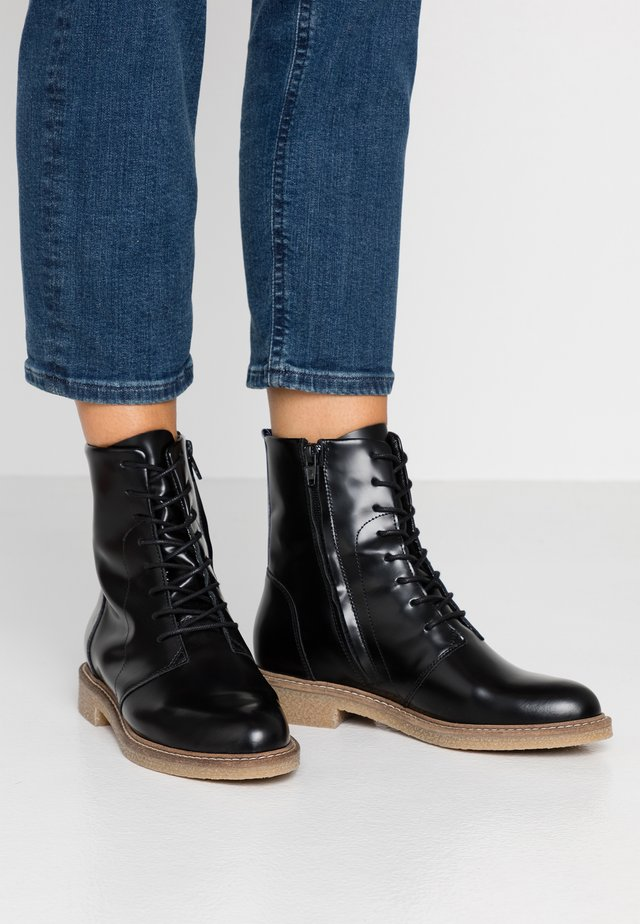 VAGOS - Lace-up ankle boots - black