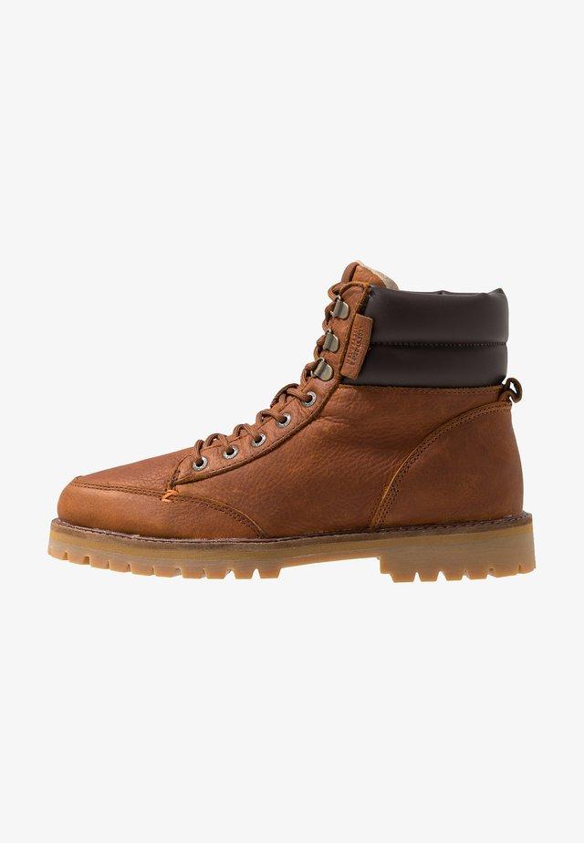 BELFAST - Lace-up ankle boots - cognac