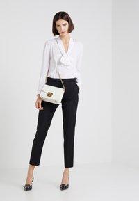 HUGO - HEFENA - Oblekové kalhoty - black - 1