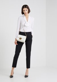 HUGO - HEFENA - Pantaloni eleganti - black - 1