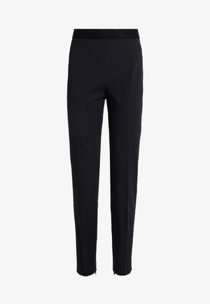 HOLISA - Trousers - black