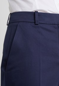 HUGO - HERILA - Trousers - open blue