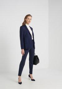 HUGO - HINELA - Trousers - open blue - 1