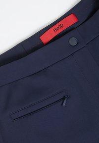 HUGO - HINELA - Trousers - open blue - 3