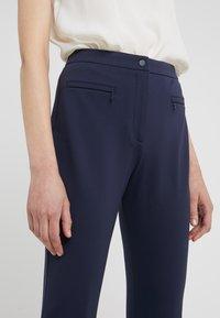 HUGO - HINELA - Trousers - open blue - 6