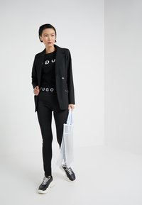 HUGO - NAFTY - Leggingsit - black - 1