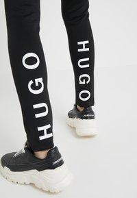 HUGO - NAFTY - Leggingsit - black - 4