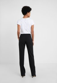 HUGO - THE REGULAR TROUSERS - Broek - black