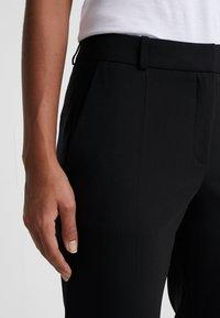 HUGO - Pantaloni - black - 4