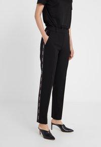 HUGO - THE SLIM TROUSERS - Trousers - black/white - 0