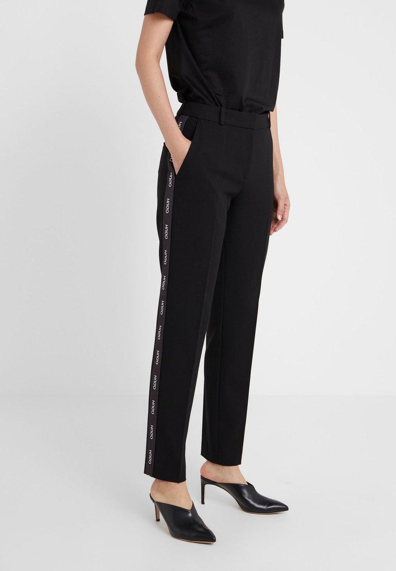 HUGO - THE SLIM TROUSERS - Trousers - black/white