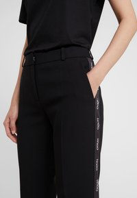 HUGO - THE SLIM TROUSERS - Trousers - black/white - 5