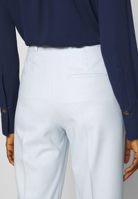 HUGO - HERILA - Trousers - light pastel blue