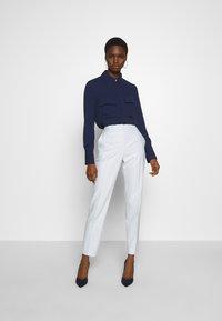 HUGO - HERILA - Kalhoty - light pastel blue - 1