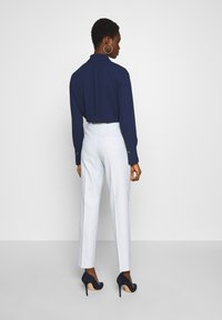 HUGO - HERILA - Kalhoty - light pastel blue - 2
