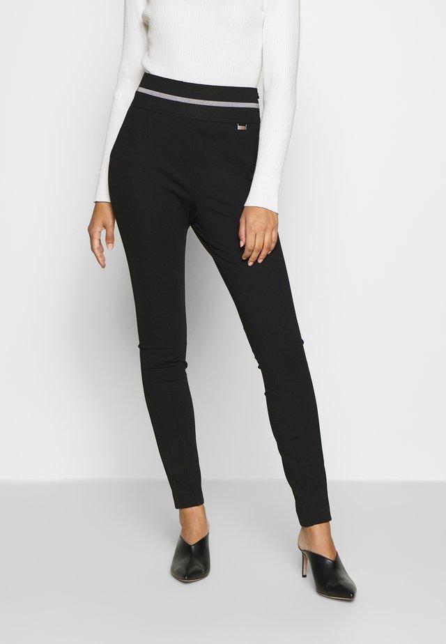 HIRUBA - Leggings - Trousers - black