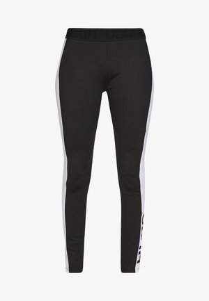 NOURY - Leggingsit - black