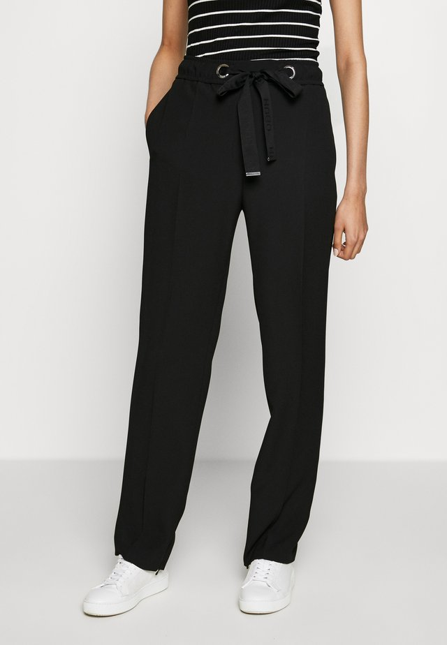 HILIKA - Pantalones - black
