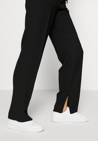HUGO - HILIKA - Trousers - black - 3