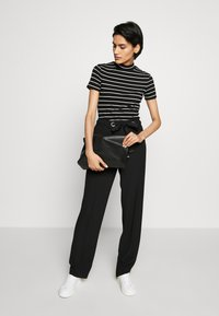 HUGO - HILIKA - Trousers - black