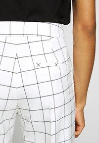HUGO - HETENI - Trousers - beige - 4