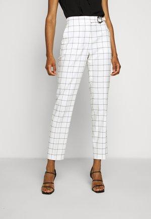 HETENI - Trousers - beige