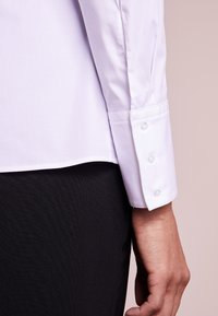 HUGO - ETRIXE - Button-down blouse - open white - 4