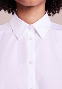 HUGO - ETRIXE - Button-down blouse - open white - 3