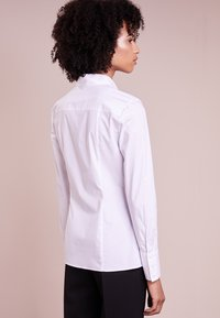 HUGO - ETRIXE - Button-down blouse - open white - 2