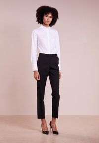 HUGO - ETRIXE - Button-down blouse - open white - 1