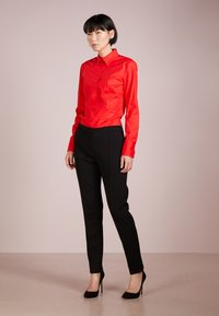 HUGO - ETRIXE - Button-down blouse - medium red - 1