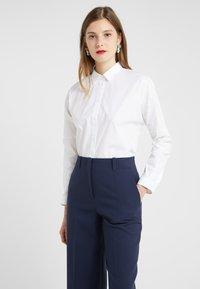 HUGO - EVANETT - Button-down blouse - open white - 0