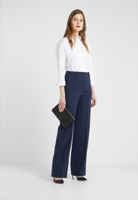HUGO - EVANETT - Button-down blouse - open white - 1
