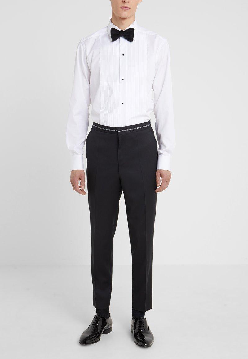 HUGO - HENING - Oblekové kalhoty - black