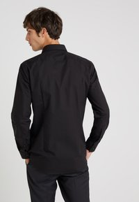 HUGO - JENNO SLIM FIT - Formal shirt - black - 2