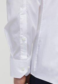 HUGO - ELISHA EXTRA SLIM FIT - Koszula biznesowa - open white - 5