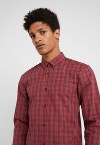 HUGO - ERO EXTRA SLIM FIT - Shirt - dark orange - 4