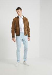 HUGO - HELDOR - Pantaloni - light pastel blue - 1