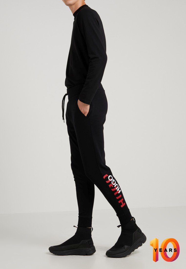 HUGO - DOAK - Tracksuit bottoms - schwarz