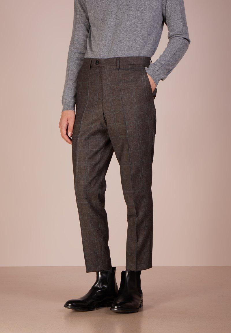 HUGO - HENING - Trousers - rust/copper