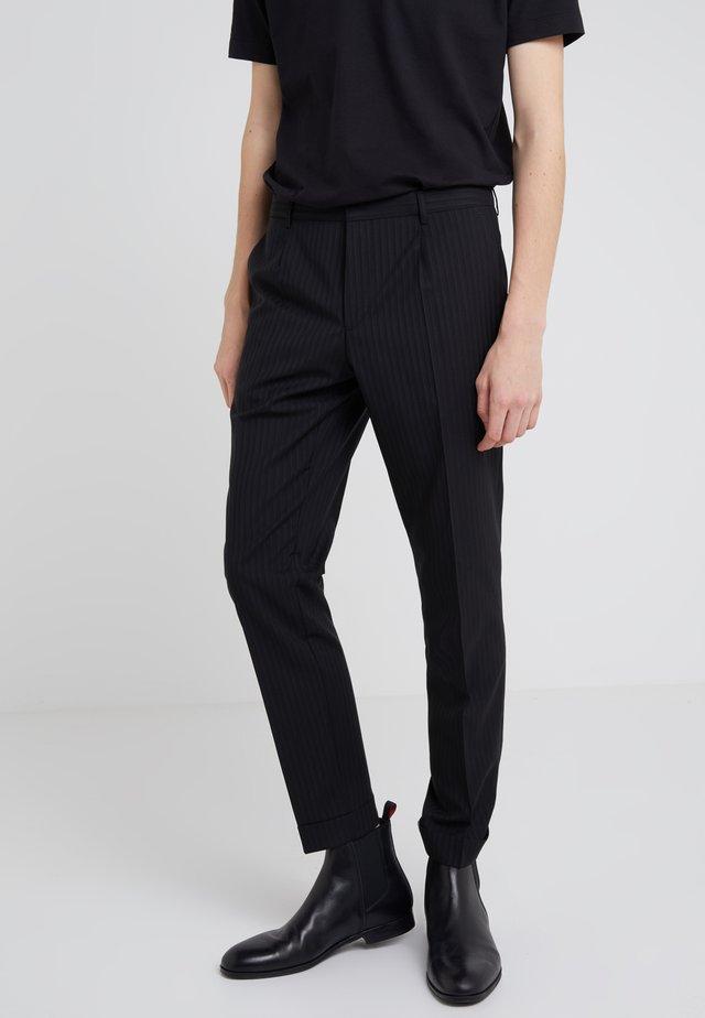GABRIEL - Pantalones - black
