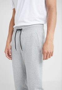 HUGO - DOAK - Tracksuit bottoms - open grey - 4