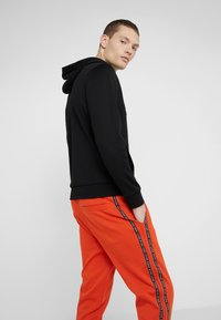 HUGO - DRAPANI - Trainingsbroek - dark orange - 3